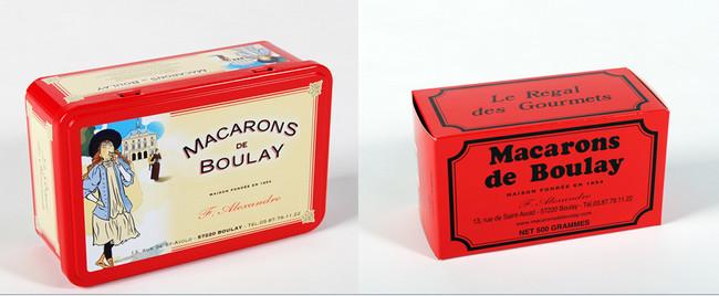 De gauche à droite : La boîte style Belle-Époque a vu le jour grâce à un graphiste anglais. ©Maison Alexandre   La traditionnelle et célèbre boîte en carton rouge des notoires Macarons de Boulay. ©Maison Alexandre .