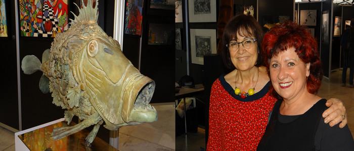 De gauche à droite : Le poisson aquatique Saint-Pierre (bronze) du sculpteur Thierry Benenati, l'un des deux invités d'honneur, de cette édition vittelloise 2018.©Bertrand Munier;  Paquita Madrid (à gauche), présidente de l'association Art'East et du salon international de Vittel, aux côtés de sa vice-présidente Èva Maqueda, artiste peintre espagnole.  ©Bertrand Munier